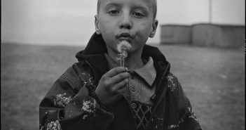 © Oleg Videnin, Denis and dandelion, Baikal, 2003